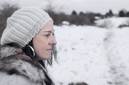 worried woman in snow covered fields